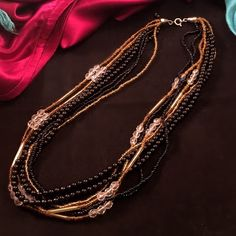 """VINTAGE Multi Strand 80s Necklace 18"""" long. Pretty seed and mini beads in black and gold highlights by larger clear beads. Vintage Jewelry Necklaces"""