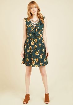 Late-Night Dinner Date Floral Dress   Mod Retro Vintage Dresses   ModCloth.com The easy panache of this green dress inspires you to switch up your weeknight and make reservations - after eight o'clock! With a crisscross, ruffled neckline and a yellow, ivory, and brown floral print, this frock makes for a well-done style statement on this rather rare occasion.