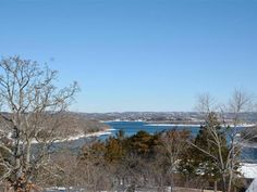 #Bransonareahomeforsale #TableRocklakeview. Are you looking for the perfect lake home Step out onto your front partially covered composite deck and see Table Rock Lake and the Kimberling City Bridge. The home sets on a large lot w a gentle slope.  The kitchen is loaded with cabinets and newer appliances recently repainted and re-carpeted. The views of the lake can be seen from the family areas kitchen & dining.  Call Sharol @ 417-593-2010 or search for homes @ TableRockRealtyGroup.com
