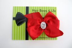 Hair Bows 4 Life- adorable hair bows for little girls with religious medals in the middle. My girls have Christmas ones with medals of the Holy Family!