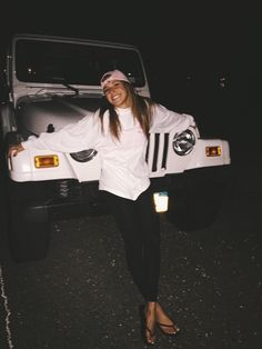 Looks like she's wearing a spirit jersey. Northern Preppy Girl. Love the baseball hat and jeep