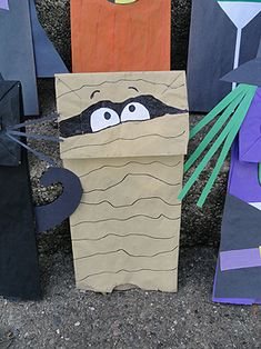 Fun way to do school take home treats!  Turn a lunch sack into a take home puppet!    Halloween Paper Bag Puppets   Make and Takes