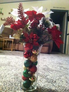 floral arrangement.  ---  SUCH a cute idea for christmas this what im doing in my tall vase in the foyer