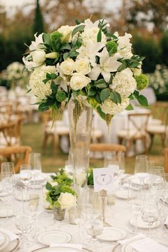 Fleur + Stitch- Similar in size and shape to centerpiece option 1. I wouldn't use the lilies in it. The gold option could easily be switched out to a clear vase like this