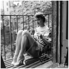 Jean Patchett escaping the heat on the fire escape of Eileen Ford's agency, photo by Nina Leen, New York City, July1948 a