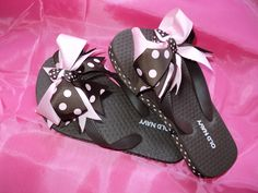 Like a chocolate and strawberry confections for those sweet little feet..Old Navy brown flips flops with great ribbon detail!