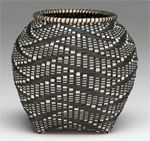 Basketmaker Sharon Dugan used natural and keyed ash splint, birch rims