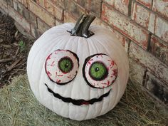 Iggy, the Halloween zombie pumpkin!  I did this one with a real pumpkin, and just painted him white, and used styrofoam balls from Wal-Mart for his eyes! This Halloween I intend to make one out of a foam pumpkin!  #halloween #pumpkin #pumpkindecorating #cutepumpkin