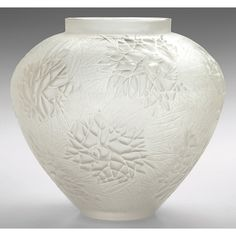 R. Lalique vase, bulbous shape in frosted glass with a stylized floral and leaf pattern, marked
