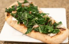 Naan with Goat Cheese, Sauteed Chard, and Crispy Shallots
