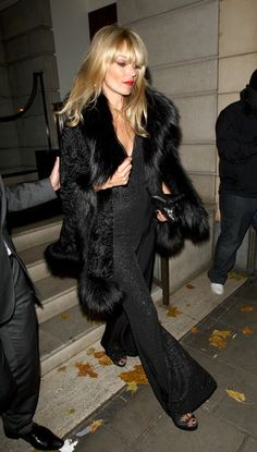 kate moss in furs | Kate Moss Kate Moss, wearing a sparkly jumpsuit and fur overcoat, is ...