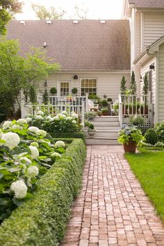 Pinned Curb Appeal Ideas The brick walkway flawlessly draws eyes and foot traffic to the home's entry point, the deck.The brick walkway flawlessly draws eyes and foot traffic to the home's entry point, the deck.