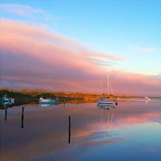 Sunset reflections at Strahan on Tasmania's West Coast. Strahan's unique location also makes it the perfect place to escape the pressures of modern life without getting too far off the beaten track. #discovertasmania #tasmania. #Strahan #westcoast #sunset Image Credit: Jaharn Giles