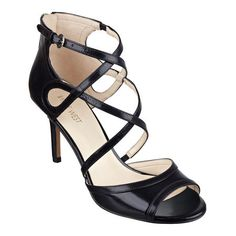 """Slender crisscrossing straps bring a fresh take on the classic peep toe pump. Padded footbed provides all-day, into-the-evening comfort. Adjustable ankle strap closure. Leather upper. Man-made lining and soles. Imported. 3"""" mid heels."""
