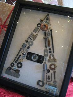 For the fix-it husband: use nuts and bolts and screws and nails to make the initial. Attach with hot glue on a thick piece of cardboard or cardstock. Frame.hmmm my hubs is not the fix it but he is a golfer
