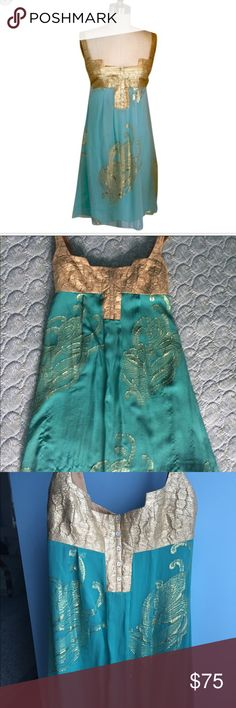 Nicole Miller empire waist dress Gorgeous turquoise and gold flowy dress in excellent used condition. There are a few loose gold threads that the camera couldn't pick up. Knee length, low-cut in front, perfect vacation dress! Nicole Miller Dresses