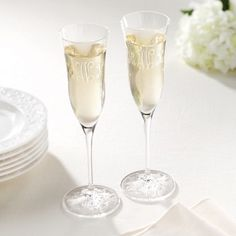 Wedding Toasting Flutes. From Waterford, this sophisticated yet understated pattern has simple, fluid lines with a brilliantly-cut star on the base. From Exclusively Weddings. #exclusivelyweddings
