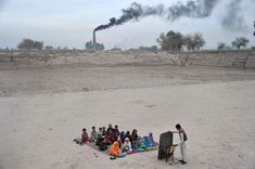 Afghan schoolchildren take lessons in an open classroom at a refugee camp on the outskirts of Jalalabad, Nangarhar province on December 1, 2013. Afghanistan has had only rare moments of peace over the past 30 years, its education system being undermined by the Soviet invasion of 1979, a civil war in the 1990s and five years of Taliban rule. (Noorullah Shirzada / AFP / Getty Images)