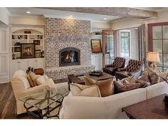 """this room is too """"stuffy"""" for me, but I do like the brick fireplace/mantel"""