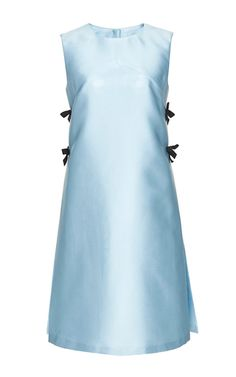 This **Carolina Herrera** sleeveless dress is rendered in a polyester silk blend and features a high round neck, side pleats with bows, and a mid length hem.