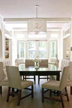 Lovely Square Dining Room With Oly Studio Serena Drum Chandelier Over Glossy Black Table Surrounded By Nailhead Chairs And Tufted