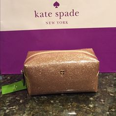 """Kate Spade cosmetic pouch Kate Spade medium Davis cosmetic pouch. Glitter rose gold color. Fabric lined interior with slip pocket on one side. Approximate dimensions are 7.75"""" x 3.75"""" x 4"""" high. Comes with Kate Spade care card. kate spade Bags Cosmetic Bags & Cases"""