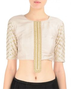 Stone gray colored elbow sleeved blouse. Round neckline. Golden faux leather applique art adorn the sleeves and central placket. Black lengha with golden faux leather hem.Wash care: Dry clean only