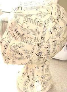 Cover foam head with Mod Podge music sheets. Cute accessory.