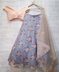 Grey and Peach off shoulder Lehenga Choli Features a banglori silk blouse with chikanakari work alongwith organza lehenga with can can layered.Comes with organza dupatta. Indian Gowns Dresses, Indian Fashion Dresses, Indian Designer Outfits, Indian Outfits, Lehnga Dress, Lehenga Blouse, Lehenga Choli, Blue Lehenga, Indian Wedding Lehenga