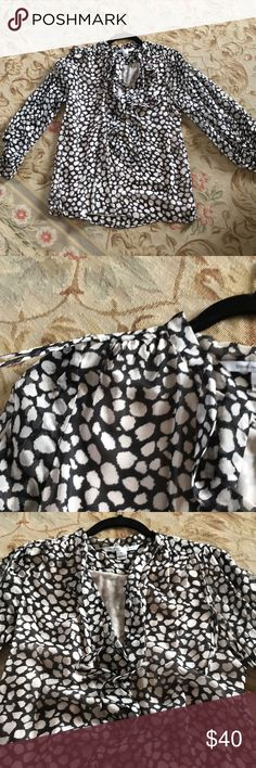 DVF spotted tie-neck blouse, 6 Classic DVF. Spotty leopard like print on creamy blush and black. Unique gather and tie on shoulders. Tie neck option or leave open and dangling for a sexier look. Body is lined, sleeves are sheer.  Excellent condition. Great for work with a pencil skirt or make more fun with leather pants on the weekends! Diane Von Furstenberg Tops Blouses