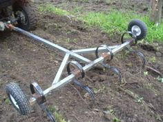 Homemade chisel plow constructed from square tubing, flat bar stock, and wheels. Garden Tractor Attachments, Atv Attachments, Garden Tool Storage, Garden Tools, Homemade Tractor, Food Plot, Small Tractors, Tractor Implements, Farm Tools