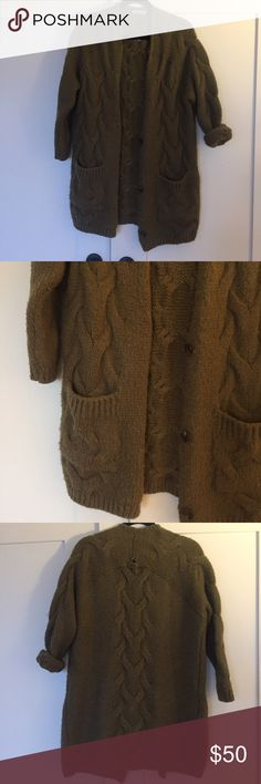 Comfy military green wool cardigan Not worn many times - military green cardigan, super comfy not itchy at all. 80% wool 20% acrylic. Has a whole in back as seen in pic - could easily be fixed. One size but it's more like a S I would say fits a lil oversize which is nice. Sweaters Cardigans