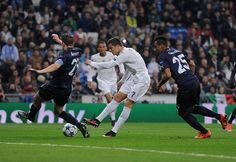 Cristiano Ronaldo of Real Madrid scores Real's 5th goal during the UEFA Champions League Group A match between Real Madrid CF and Malmo FF at the...
