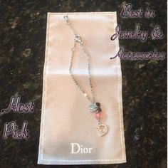 "HPNWT Authentic Dior Bracelet Precious little Dior bracelet with pink and silver hearts and signature Dior ""D"" with rhinestones. NWT! Adjustable to 3 sizes to fit all wrists. Bought at Dior outlet in Orlando, FL. Never worn except tried on. Comes in little gray felt bifold pouch. Host Pick by the lovely @j00nbug1 for Best in Jewelry & Accessories Party 4/1/16 Dior Jewelry Bracelets"
