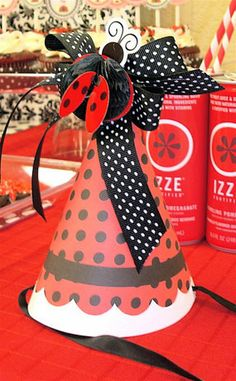 red and black ladybug first birthday party dessert table hat with ribbons