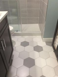 Design your existing living decor with a classic and modern style by choosing this durable Merola Tile Textile Hex White Porcelain Floor and Wall Tile. Hexagon Tile Bathroom Floor, Small Bathroom Tiles, Bath Tiles, Bathroom Tile Designs, Upstairs Bathrooms, Bathroom Ideas, Bathroom Tile Showers, Home Depot Bathroom Tile, Grey Bathroom Floor
