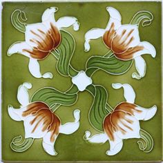 An Art Nouveau low relief tile with a stylised quadruple flower head and swirled leaf design in cream, brown, and...