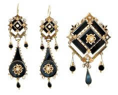 Victorian mourning demi suite brooch ear pendants                                                    Victorian mourning demi suite of jewelry;  set in 10k yellow gold, comprised of a brooch with matching ear pendants of black onyx/jet and pearl accents. Total suite weight 34.7 grams