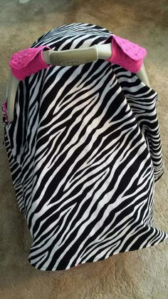 Zebra carseat canopy come visit us at Motherly-love.com and our facebook page