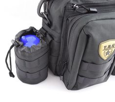 TBG Bottle Pouch 2.0       Features:  Thermal Padded bottle compartment with drain grommet in bottom MOLLE compatible Durable materials with reinforced construction Pull drawstring  With its quick-draw open drawstring design, the Tactical Baby Gear thermal linedbottle pouch lets you silence that hungry baby with speed and precision. Whether it's a few ounces between feedings or a day's rations, your baby's bottle will be secure in this snug universal-fitting harness. The MOLLE-compatible…