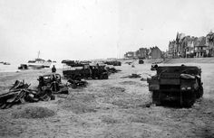 German troops inspect abandoned British & French cars, trucks and other vehicles on the beach of Dunkirk, 1940.