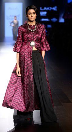 Amoh by JADE. Garnet hued jacket style slit chevron kurta made of Banarasi handloom paired with black palazzo pants