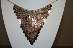 11/16-#JB234 Great vintage silver tone chainmail necklace featuring a bib of copper colored sequins discs. Overall good vintage shape. Nice working clasp in the back. Measures 19 inches from end to end. Total weight of 0.7 ounces. All jewelry comes with a jewelry box. I take a lot of similar pictures under different lighting conditions so that you have a good understanding of the item youre buying. I have lots of vintage and antique jewelry for sale. Please take a look at my other listin...