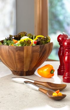 Love the mix of wood and silvertone metal. It's the perfect mix of rustic and modern | Salad bowl and servers.