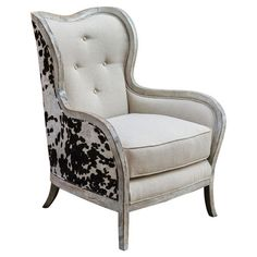 Pairing classic elegance with ranch-chic appeal, this distinctive arm chair showcases an exposed wood frame and cowhide-print upholstery.   ...
