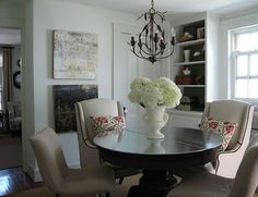 love the round wood pedestal table, upholstered chairs, built-ins....its all good