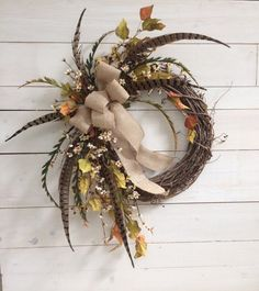 Burlap Bow and Pheasant Feather Wreath / Fall by WreathOnEveryDoor