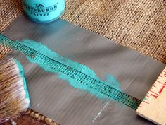 Turquoise stripe painted onto burlap table runner