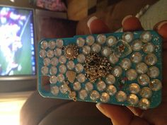 My home made phone case with old charms, rhinestones and glue gun ;)