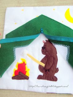 Camping - zipper, bear with marshmallow over fire